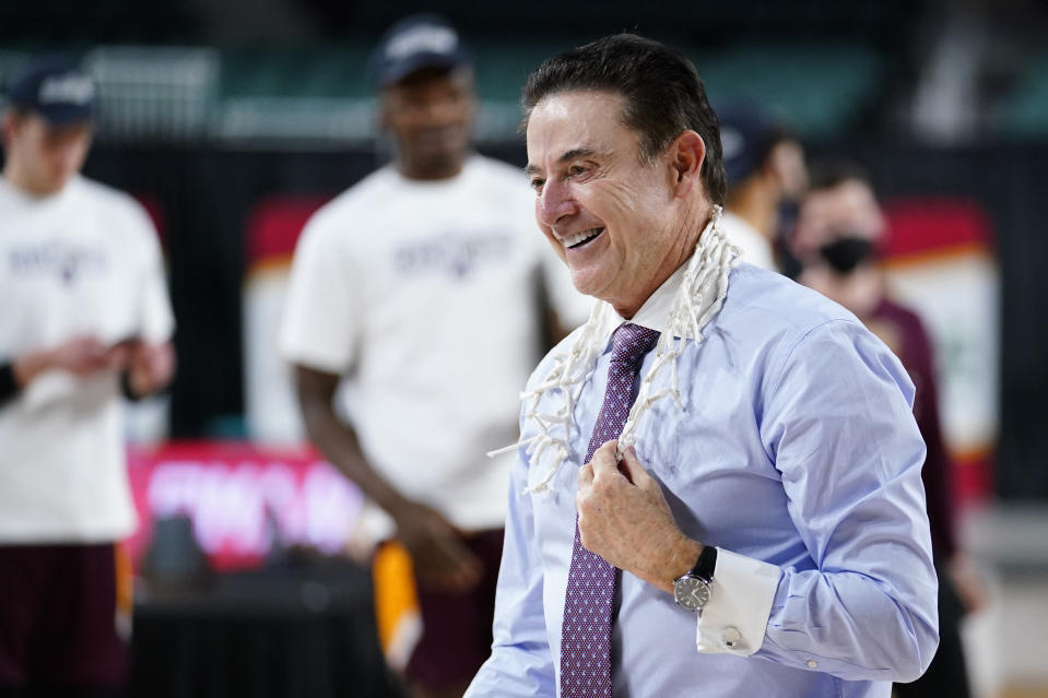 FILE - Iona head coach Rick Pitino celebrates after Iona won an NCAA college basketball game against Fairfield during the finals of the Metro Atlantic Athletic Conference tournament in Atlantic City, N.J., in this Saturday, March 13, 2021, file photo.Rick Pitino survived sex scandals and FBI investigations , won national championships , and when his coaching options seemingly dried up , he left for Greece. Somehow , the winding road of his career took him to Iona - and back in the NCAA Tournament. The last stop - he swears it's true - of his career. (AP Photo/Matt Slocum, File)
