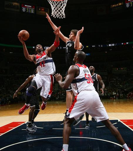 WASHINGTON, DC - FEBRUARY 8: Nene #42 of the Washington Wizards shoots against Brook Lopez #11 of the Brooklyn Nets during the game at the Verizon Center on February 8, 2013 in Washington, DC. (Photo by Ned Dishman/NBAE via Getty Images)