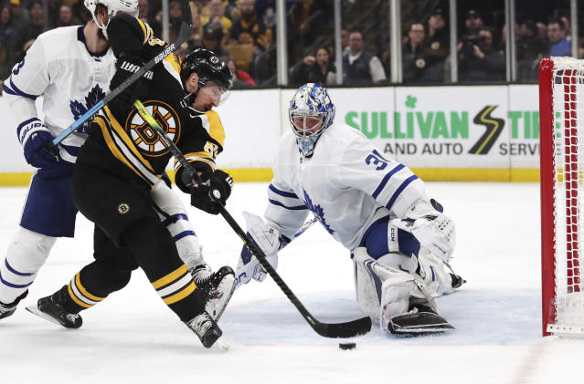 FILE - In this April 23, 2019, file photo, Boston Bruins left wing Brad Marchand, left, tries unsuccessfully to shoot past Toronto Maple Leafs goaltender Frederik Andersen (31) during the second period of Game 7 of an NHL hockey first-round playoff series, in Boston. With Tampa Bay, Boston, the Toronto Maple Leafs and refueled Florida Panthers, the Atlantic Division looks like murderers row. The Bruins got through only after coming back from a 3-2 first-round deficit against Toronto and arent feeling overly cocky because the same rocky road remains. (AP Photo/Charles Krupa, File)