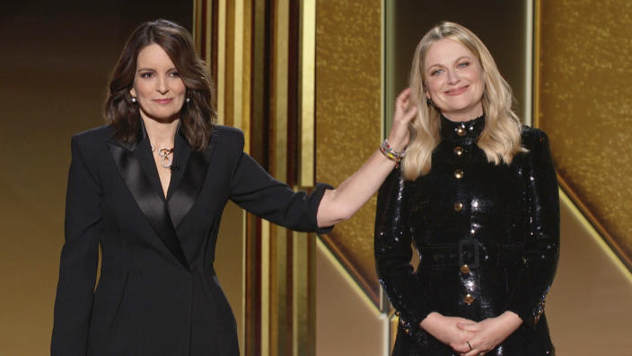 In this video grab issued Sunday, Feb. 28, 2021, by NBC, hosts Tina Fey, left, from New York, and Amy Poehler, from Beverly Hills, Calif., speak at the Golden Globe Awards. (NBC via AP)