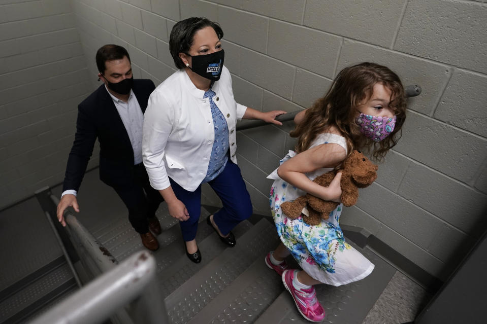 Democratic gubernatorial candidate, Virginia State Sen. Jennifer McClellan, center, walks up the stairs to an early voting location witch her daughter, Samantha Mills and husband Dave Mills at an early voting location in Richmond, Va., Saturday, May 29, 2021. McClellan faces four other Democrats in the primary. (AP Photo/Steve Helber)