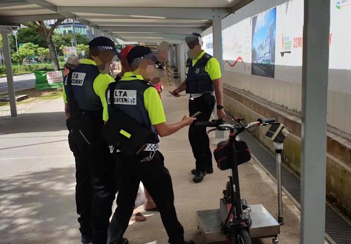 LTA officers catching an errant e-scooter rider on 1 January 2020, the first day strict enforcement actions kicked in. (PHOTO: Land Transport Authority)