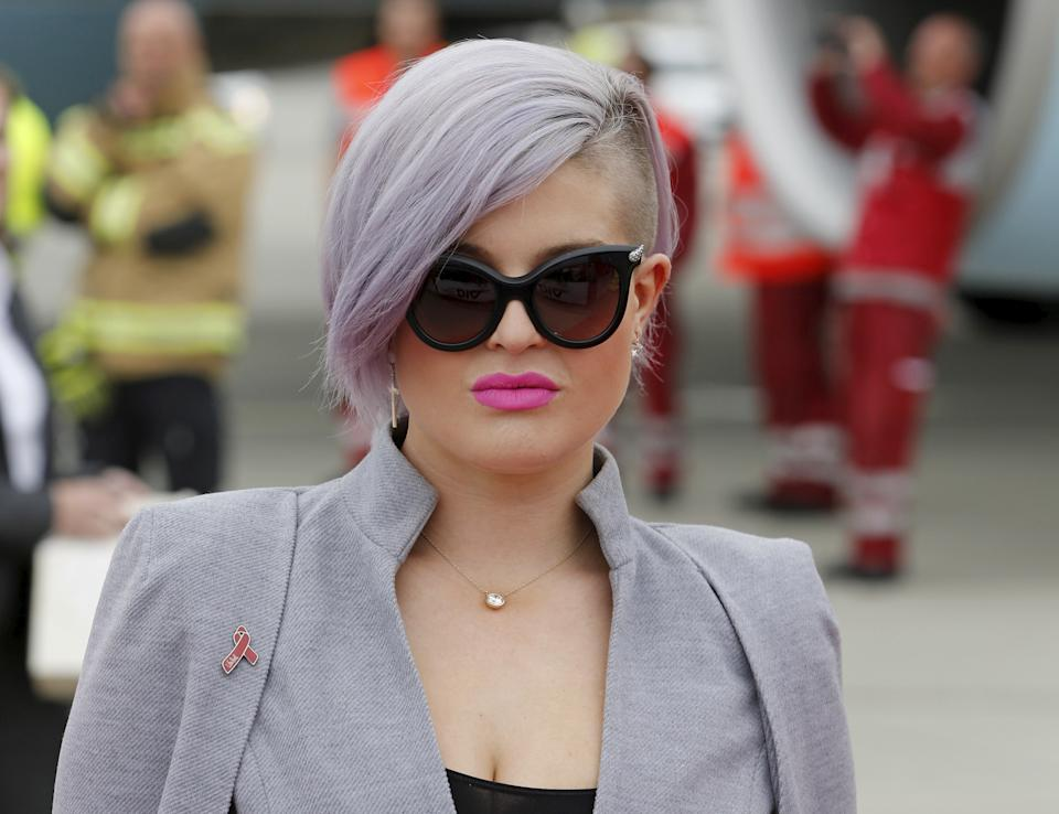TV personality Kelly Osbourne poses upon her arrival for the Life Ball at the airport in Vienna, Austria, May 15, 2015. Life Ball is Europe's largest annual AIDS charity event and takes place at the Vienna city hall on May 16, 2015. REUTERS/Leonhard Foeger