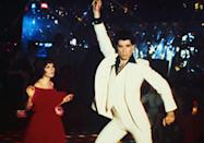 """<p>If John Travolta can do it, then so can dad. Men busted out their flared pants and platform shoes to give """"the Hustle"""" a try, inspired the release of <em><a href=""""https://www.amazon.com/Saturday-Night-Anniversary-Special-Collectors/dp/B000SQFC0Y?tag=syn-yahoo-20&ascsubtag=%5Bartid%7C10055.g.21205120%5Bsrc%7Cyahoo-us"""" rel=""""nofollow noopener"""" target=""""_blank"""" data-ylk=""""slk:Saturday Night Fever"""" class=""""link rapid-noclick-resp"""">Saturday Night Fever</a></em>. </p>"""