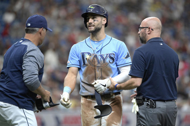 Tampa Bay Rays' Kevin Kiermaier (39) is checked by manager Kevin Cash, left, and a trainer after being hit by a pitch from Boston Red Sox starting pitcher Nathan Eovaldi during the fourth inning of a baseball game Sunday, Sept. 22, 2019, in St. Petersburg, Fla. (AP Photo/Phelan M. Ebenhack)