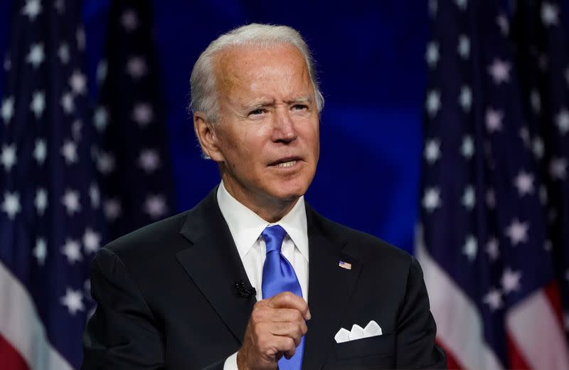 In convention speech, Biden emerges from shadow and into 'the light'