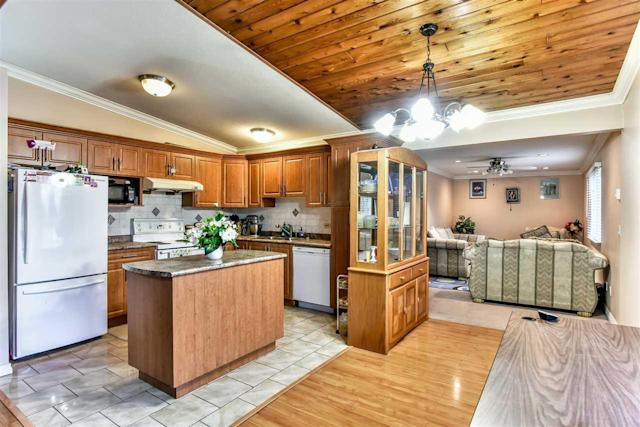 <p><span>8852 148 Street, Surrey, B.C.</span><br> The kitchen includes the fridge, stove and dishwasher.<br> (Photo: Zoocasa) </p>