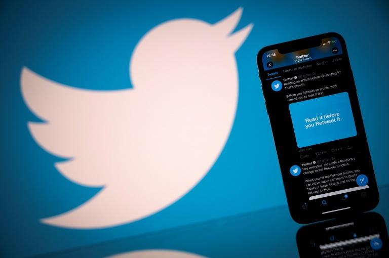 This photograph taken on October 26, 2020 shows the logo of US social network Twitter displayed on the screen of a smartphone