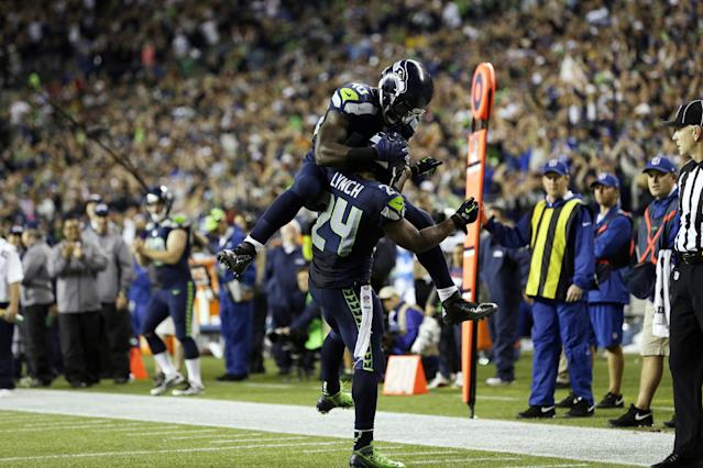 Seattle Seahawks' Derrick Coleman jumps on Seahawks' Marshawn Lynch (24) after Lynch scored his second touchdown of the second half of an NFL football game against the San Francisco 49ers, Sunday, Sept. 15, 2013, in Seattle. (AP Photo/Elaine Thompson)