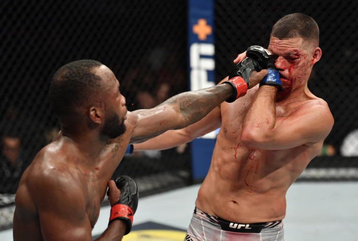 GLENDALE, ARIZONA - JUNE 12: (L-R) Leon Edwards of Jamaica punches Nate Diaz in their welterweight fight during the UFC 263 event at Gila River Arena on June 12, 2021 in Glendale, Arizona. (Photo by Jeff Bottari/Zuffa LLC)