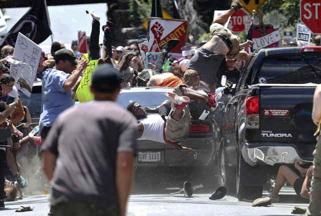 <p>People fly into the air as a vehicle drives into counterprotesters demonstrating against a white nationalist rally in Charlottesville, Va., on Aug. 12, 2017. (Photo: Ryan M. Kelly/The Daily Progress via AP) </p>