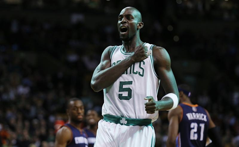 Boston Celtics power forward Kevin Garnett (5) facing the Charlotte Bobcats in the first quarter of an NBA basketball game in Boston, Monday, Jan. 14, 2013. (AP Photo/Charles Krupa)