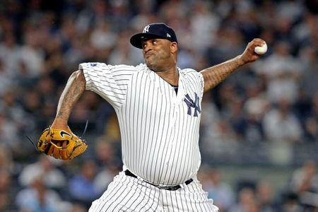 FILE PHOTO: Oct 9, 2018; Bronx, NY, USA; New York Yankees starting pitcher CC Sabathia (52) in game four of the 2018 ALDS playoff baseball series at Yankee Stadium. Mandatory Credit: Brad Penner-USA TODAY Sports
