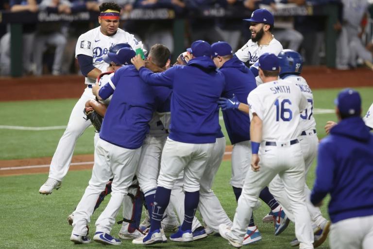 The Los Angeles Dodgers celebrate after defeating the Tampa Bay Rays to win the World Series for the first time since 1988
