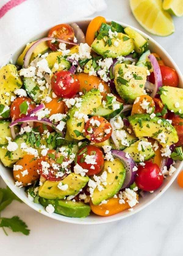 """<p>Watch out! The best summer veggies of all teamed up to make this colorful and healthy salad. With crumbled feta cheese and chopped cilantro, you'll be scraping your bowl for more. Feel free to make as much as you want, and enjoy!</p> <p><strong>Get the recipe:</strong> <a href=""""https://www.wellplated.com/cucumber-tomato-avocado-salad/"""" class=""""link rapid-noclick-resp"""" rel=""""nofollow noopener"""" target=""""_blank"""" data-ylk=""""slk:cucumber tomato avocado salad"""">cucumber tomato avocado salad</a> </p>"""
