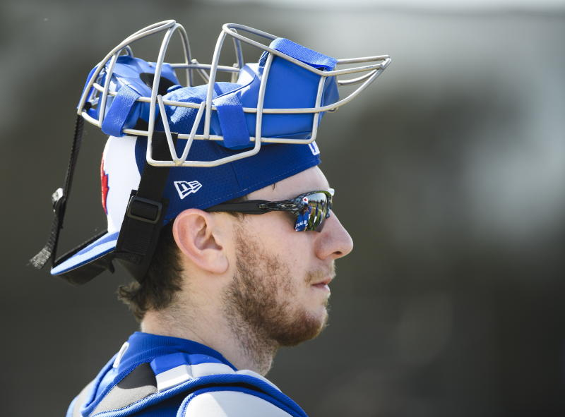FILE - In this Feb. 15, 2019 file photo, Toronto Blue Jays catcher Danny Jansen (9) looks on during spring training baseball practice in Dunedin, Fla. Just two years removed from a second consecutive ALCS appearance, the Blue Jays have turned over the core of those postseason teams and started transitioning to the future. All over the diamond this season, young players will be given the opportunity to establish themselves. (Nathan Denette/The Canadian Press via AP)