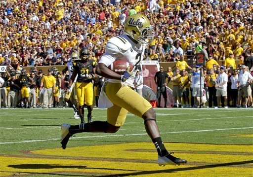 UCLA quarterback Devin Fuller (2) scores a touchdown against Arizona State during the first half of an NCAA College football game, Saturday, Oct. 27, 2012, in Tempe, Ariz. (AP Photo/Matt York)