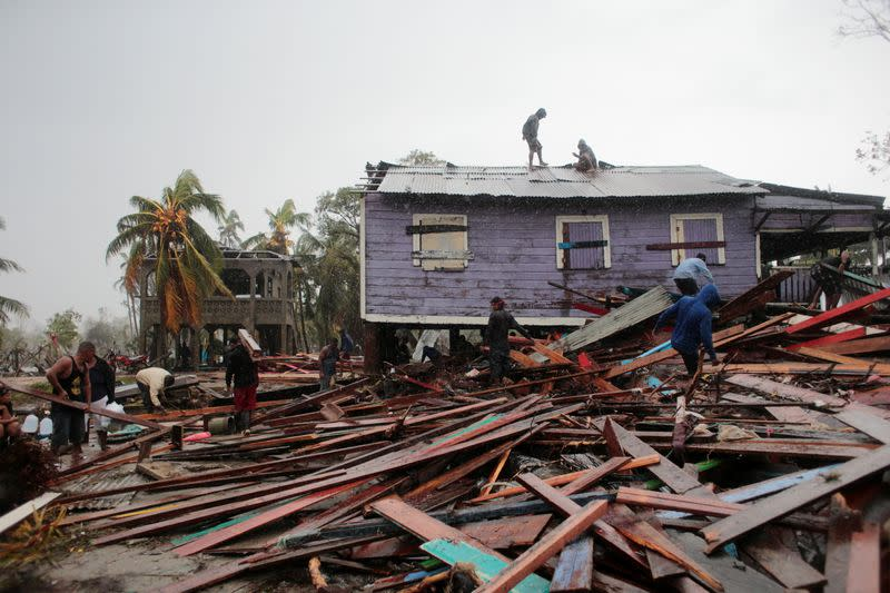 Residents remove debris from their destroyed houses after the passing of Hurricane Iota, in Puerto Cabezas