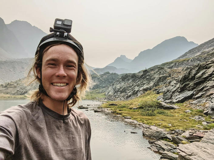 In this Sept. 12, 2020, photo provided by Jean Granberg, her son, Daniel Granberg poses for a selfie at the basin just south of Trinity and Storm King Peaks in Silverton, Colo. The body of the American man, who died while climbing one of Bolivia's highest peaks, arrived Sunday, Sept. 5, 2021, in the country's capital after a two-day recovery effort. Rescue workers said 24-year-old Granberg, of Colorado, died atop the Illimani mountain. (Daniel Granberg/Courtesy of Granberg Family via AP)