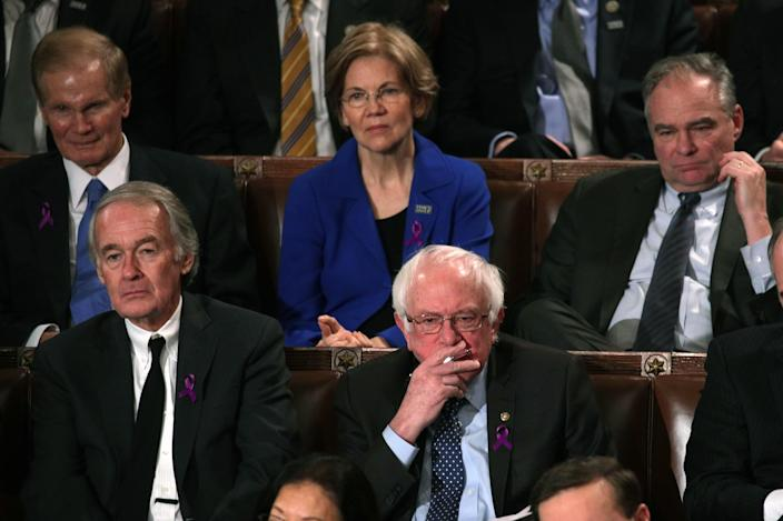 <p>Sen. Bernie Sanders, I-Vt., center, listens as Trump delivers his first State of the Union address on Jan. 30 in Washington, D.C. (Photo: Alex Wong/Getty Images) </p>