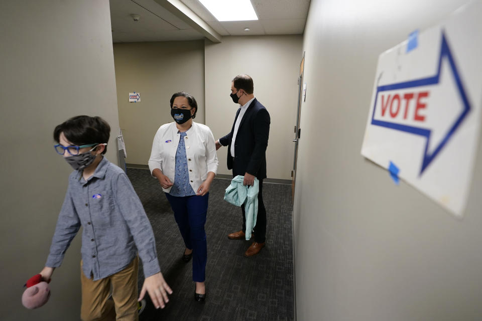 Democratic gubernatorial candidate, Virginia State Sen. Jennifer McClellan, center, leaves a voting location along with her son Jackson Mills, left, and husband, Dave Mills at an early voting location in Richmond, Va., Saturday, May 29, 2021. McClellan faces four other Democrats in the primary. (AP Photo/Steve Helber)