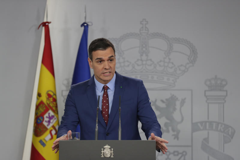 Spain's Prime Minister Pedro Sanchez addresses the media at the Moncloa Palace in Madrid, Spain, Sunday, Jan. 12, 2020.  Sanchez was chosen by Parliament as prime minister on Tuesday, ending a period in which he led a caretaker Socialist government following two inconclusive elections last year.(AP Photo/Manu Fernandez)