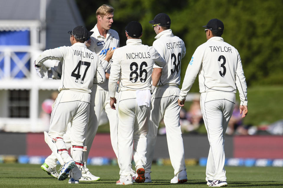New Zealand bowler Kyle Jamieson, second left, is congratulated by teammates after taking five wickets during play on the first day of the second cricket test between Pakistan and New Zealand at Hagley Oval, Christchurch, New Zealand, Sunday, Jan 3. 2021. (John Davidson/Photosport via AP)