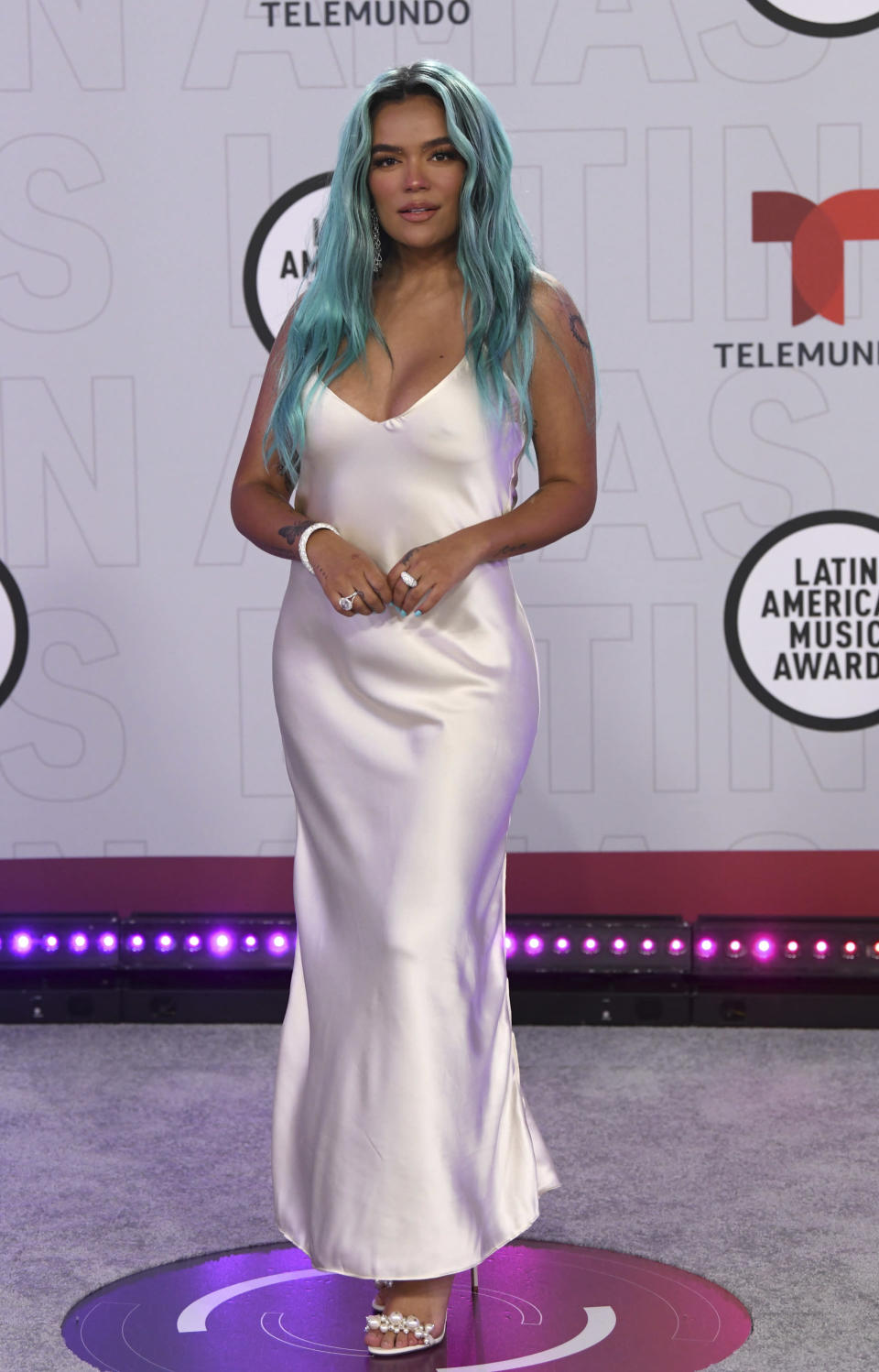Karol G arrives at the Latin American Music Awards at the BB&T Center on Thursday, April 15, 2021, in Sunrise, Fla. (AP Photo/Taimy Alvarez)
