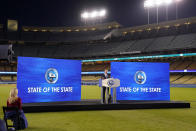 FILE In this March 9, 2021 file photo, California Gov. Gavin Newsom delivers his State of the State address from an empty Dodger Stadium as his wife Jennifer Siebel Newsom listens, in Los Angeles. Newsom suffered severe political backlash after it surfaced that he and his wife attended a party Nov. 6, 2020, with a dozen friends at the pricy French Laundry restaurant in wine country north of San Francisco. Newsom is facing the second recall of a governor in California history (AP Photo/Mark J. Terrill, File)