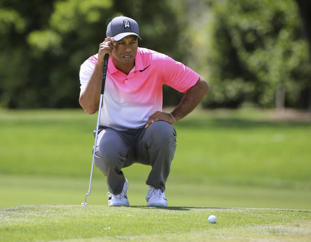 Tiger Woods lines up a putt on the first hole during the second round of the Arnold Palmer Invitational golf tournament Friday, March 16, 2018, in Orlando, Fla. (Joe Burbank/Orlando Sentinel via AP)