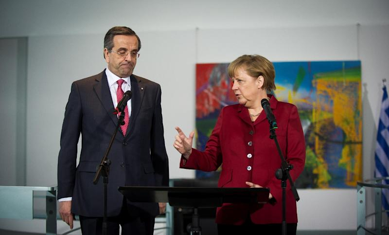 German Chancellor Angela Merkel, right, and the Prime Minister of Greece, Antonis Samaras, during a statement prior to a meeting at the chancellery in Berlin, Tuesday, Jan. 8, 2013. (AP Photo/dapd/Timur Emek)