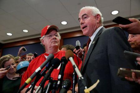 Rep. Patrick Meehan (R-PA), accompanied by Rep. Joe Barton (R-TX), speaks with the media at the U.S. Capitol Building in Washington