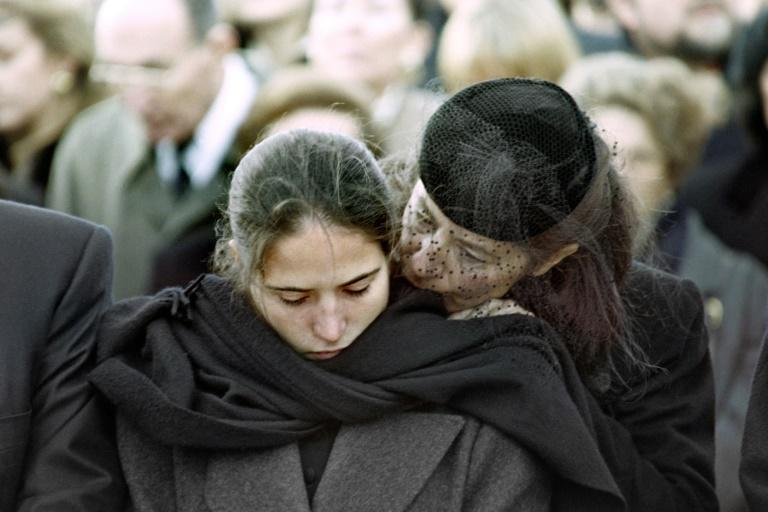 Secret family: Mitterrand's daughter Mazarine Pingeot (left) is pictured with her mother Anne Pingeot at the funeral ceremony in 1996