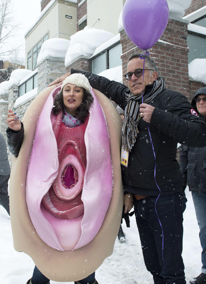 <p>Sundance Film Festival director John Cooper (R) speaks with a protester dressed as a vagina during the Women's March on Main Street at the 2017 Sundance Film Festival in Park City, Utah, January 21, 2017. (VALERIE MACON/AFP/Getty Images) </p>