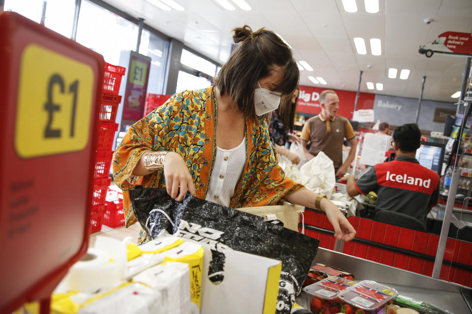 A customer wears a face mask while shopping in Iceland. (Getty)