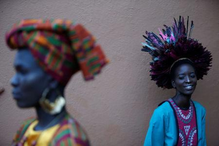 """Models wait behind the scenes before a fashion show featuring African fashion and culture during a gala marking the launch of a book called """"African Twilight: The Vanishing Rituals and Ceremonies of the African Continent"""" at the African Heritage House in Nairobi, Kenya March 3, 2019. REUTERS/Baz Ratner"""