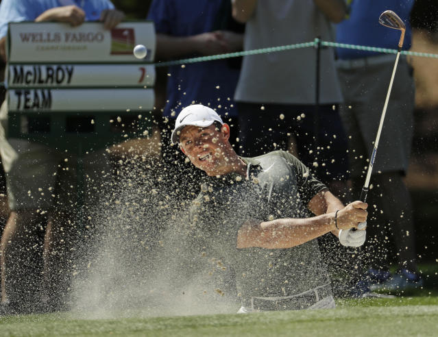 Rory McIlroy, of Northern Ireland, hits from a sand trap on the sixth hole during the pro-am of the Wells Fargo Championship golf tournament at Quail Hollow Club in Charlotte, N.C., Wednesday, May 2, 2018. McIlroy looks to bounce back after a disappointing performance at the Masters on one of his favorite courses, Quail Hollow Club. (AP Photo/Chuck Burton)