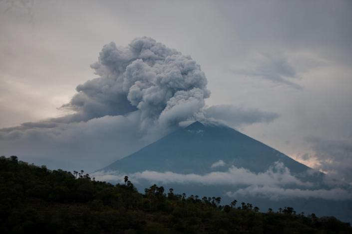 <p>Black smoke ash seen in the top of Mount Agung on November 28, 2017 in Bali, Indonesia. More than 100,000 villagers will need to leave the expanded danger zone while tens of thousands of tourists have been stranded due to airport closures. (Photo: Solo Imaji / Barcroft Media via Getty Images) </p>