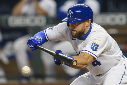 Kansas City Royals' Alex Gordon bunts during the third inning of a baseball game against the Pittsburgh Pirates in Kansas City, Mo., Saturday, Sept. 12, 2020. (AP Photo/Reed Hoffmann)