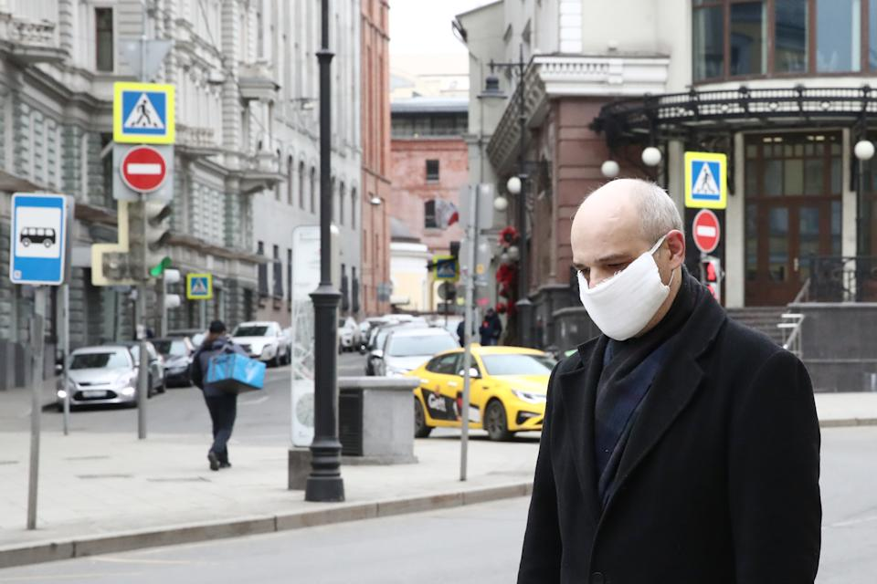 MOSCOW, RUSSIA - MARCH 30, 2020: A man in a face mask in a mostly deserted Myasnitskaya Street in central Moscow during the pandemic of the novel coronavirus (COVID-19). On 29 March 2020, Moscow's authorities issued a stay-at-home order to all people in Moscow regardless of their age, which comes into effect from 30 March 2020. Earlier, the Russian government announced a paid week off work (30 March to 3 April) for employed people and school holidays (21 March - 12 April), while Moscow's authorities ordered the shutdown of restaurants, leisure facilities and other service industry businesses and urged older Muscovites to self-isolate to counter the spread of the novel coronavirus (COVID-19). Sergei Fadeichev/TASS (Photo by Sergei Fadeichev\TASS via Getty Images)