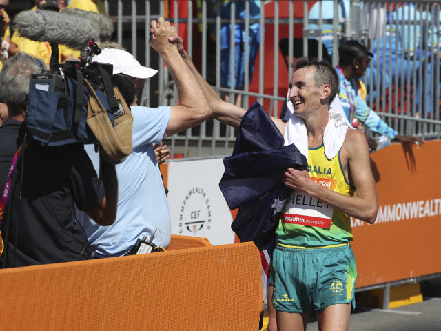Australia's Michael Shelley celebrates after winning the Men's Marathon race in the Commonwealth Games on Gold Coast, Australia, Sunday, April 15, 2018. (AP Photo/Manish Swarup)