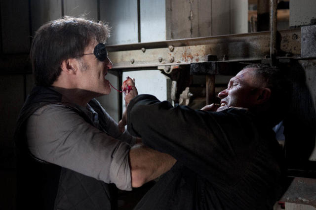 "The Governor (David Morrissey) and Merle Dixon (Michael Rooker) in ""The Walking Dead"" episode, ""This Sorrowful Life."""