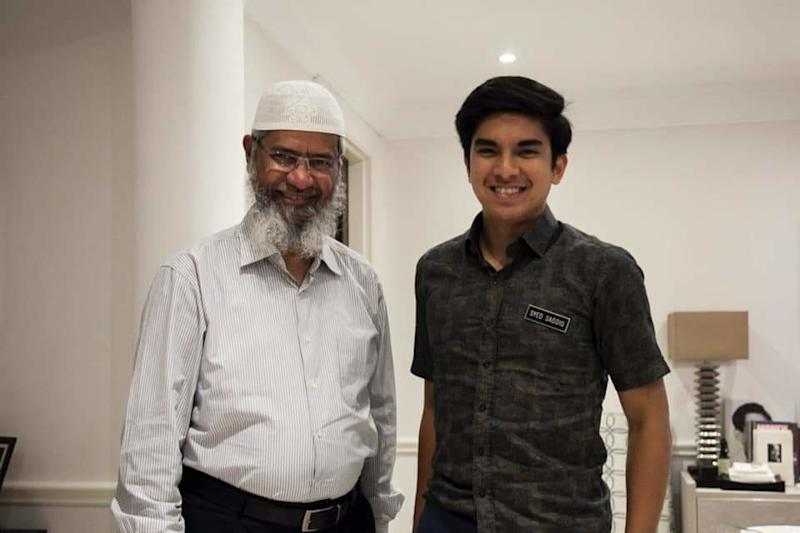 Youth and Sports Minister Syed Saddiq Syed Abdul Rahman is pictured with controversial televangelist Dr Zakir Naik at a recent dinner. — Picture via Facebook