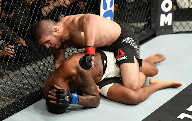 Michael Johnson fights against Khabib Nurmagomedov in their lightweight bout during the UFC 205 event at Madison Square Garden on Nov. 12, 2016 in New York City. (Getty Images)