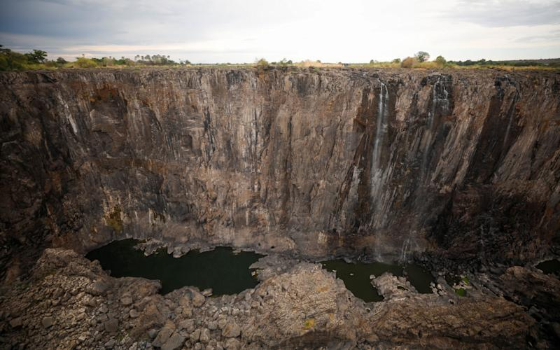 Dry cliffs are seen following a prolonged drought at Victoria Falls - REUTERS