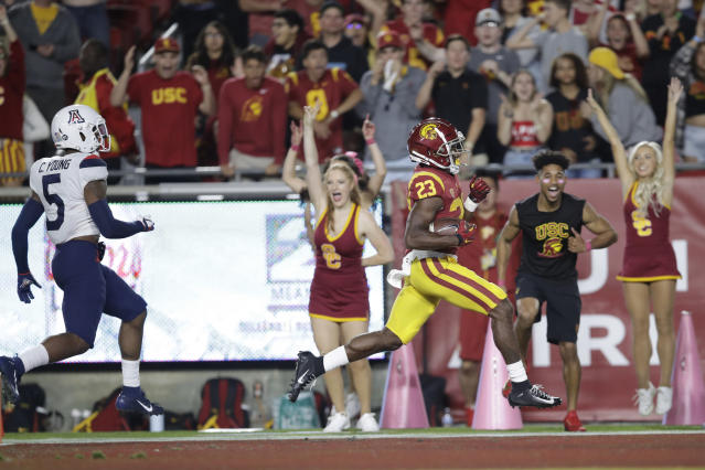 Southern California running back Kenan Christon (23) scores a rushing touchdown past Arizona safety Christian Young (5) during the second half of an NCAA college football game Saturday, Oct. 19, 2019, in Los Angeles. (AP Photo/Marcio Jose Sanchez)