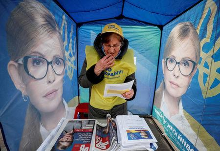 FILE PHOTO: A campaign staffer is seen in a pre-election tent for the leader of opposition Batkivshchyna party and presidential candidate Yulia Tymoshenko, in central Kiev, Ukraine March 25, 2019.  REUTERS/Gleb Garanich/File Photo