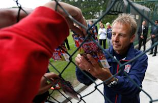 Jurgen Klinsmann signs autographs after a training session at Sao Paulo FC. (Getty Images)