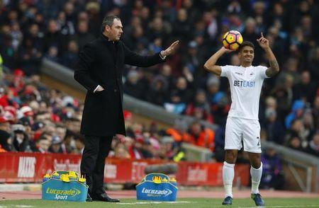 Swansea City manager Paul Clement and Kyle Naughton