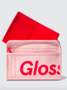 """<p><strong>Glossier</strong></p><p>glossier.com</p><p><strong>$28.00</strong></p><p><a href=""""https://go.redirectingat.com?id=74968X1596630&url=https%3A%2F%2Fwww.glossier.com%2Fproducts%2Fbeauty-bag&sref=https%3A%2F%2Fwww.harpersbazaar.com%2Fbeauty%2Fmakeup%2Fg37004535%2Fbest-toiletry-bags%2F"""" rel=""""nofollow noopener"""" target=""""_blank"""" data-ylk=""""slk:Shop Now"""" class=""""link rapid-noclick-resp"""">Shop Now</a></p><p>At first glance, this pouch may scream """"Glossier's number-one fan,"""" but its features—a removable red pouch, four interior pockets—will be handy even if the word """"Futuredew"""" means nothing to you.</p>"""